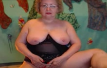 Amateur grandmother with glasses teasing