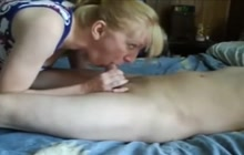 Mature woman milking a cock