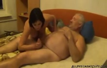 Older guy gets a blowjob from pregnant girl